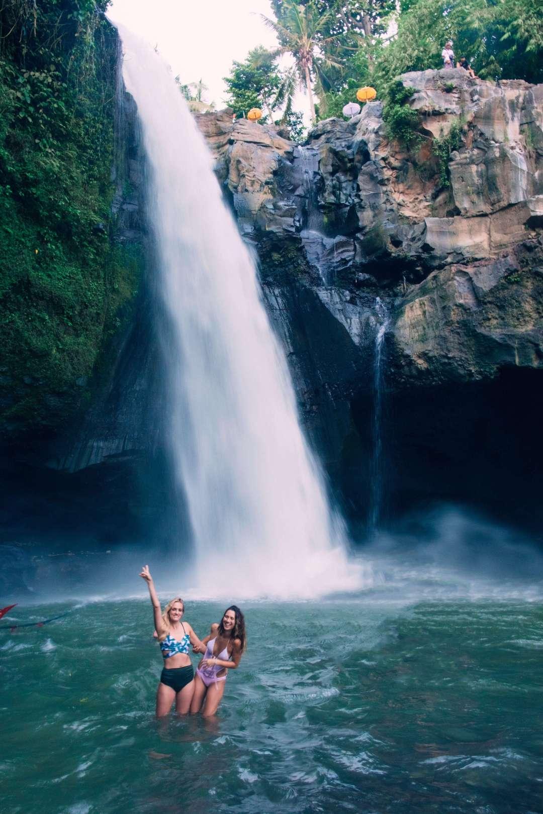 Girls in front of Tegenungan Waterfall