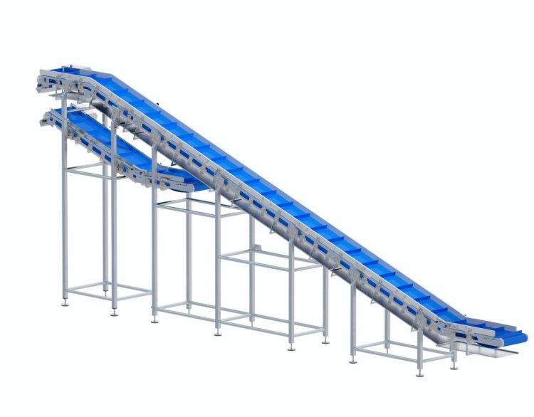 Taśmociąg typu Z doprowadzający produkt z poziomu podłogi na układ przenośników transferowych