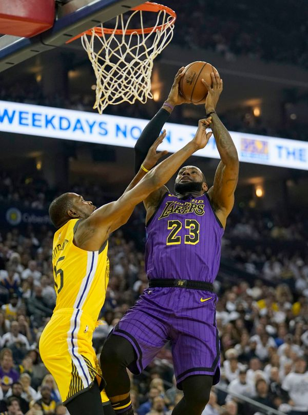 Lakers lose LeBron James to groin injury, rout Warriors