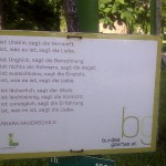 """It is what it is"" poem from Erich Fried dedicated to a loved one on a rose bush in Vienna's Volksgarten"