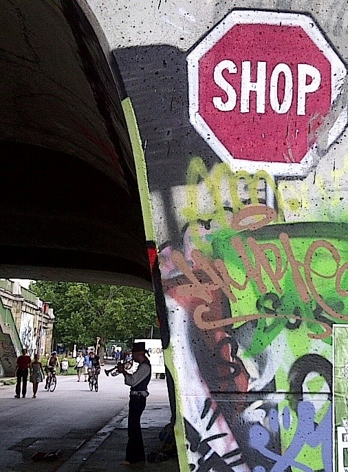 Shop graffiti and trumpet playing guy on the Waltz, Donaukanal, Vienna, Austria