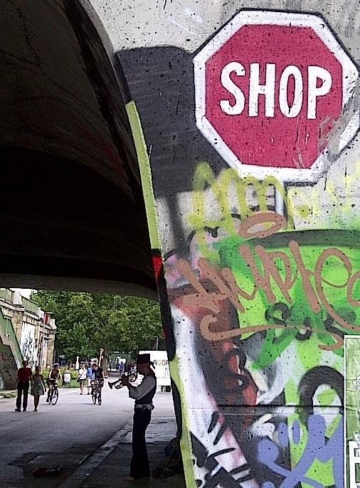 Shop graffiti and trumpet playing guy on the Waltz, Donaukanal, Vienna, Austria