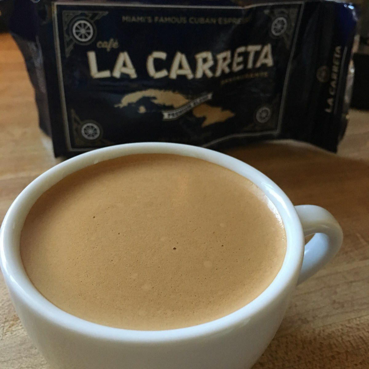 Cuban Coffee | Coffee shop patrons gossip, drink cuban