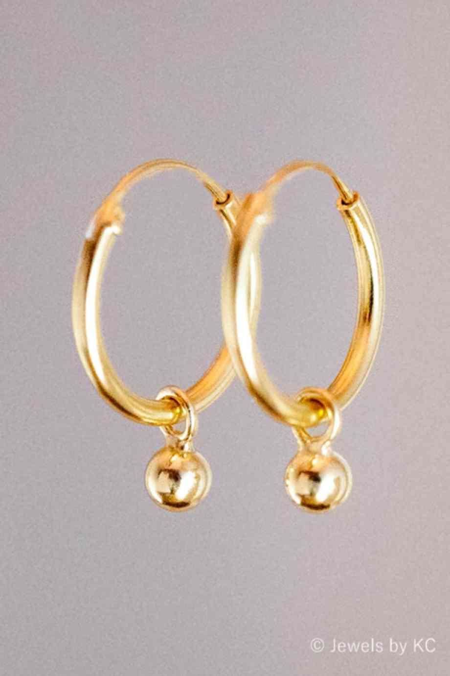 Gouden oorbellen met bolletjes van Goud op Zilver