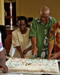 Staff-Members-Take-The-First-Cut-of-The-Cake