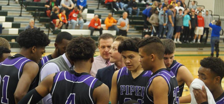 The+Pirates+gather+in+a+huddle+late+in+the+3rd+quarter.+The+Pirates+would+go+on+to+beat+Gardner+for+the+second+straight+year.+