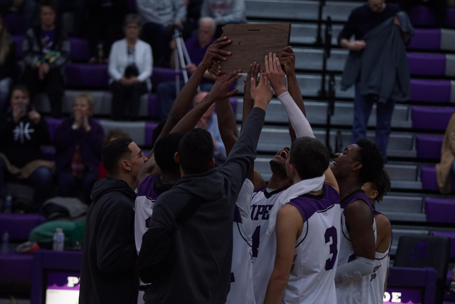 The Pirate boys lift the Sub-State plaque in celebration after beating Field Kindley High School.