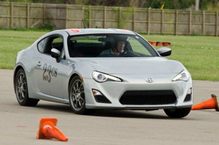 Gus Jacob rotating his No. 23 CS 2013 Scion FR-S  around a difficult cone .