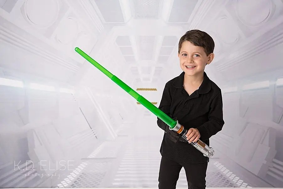 Four year old boy in a Star Wars themed photo shoot.