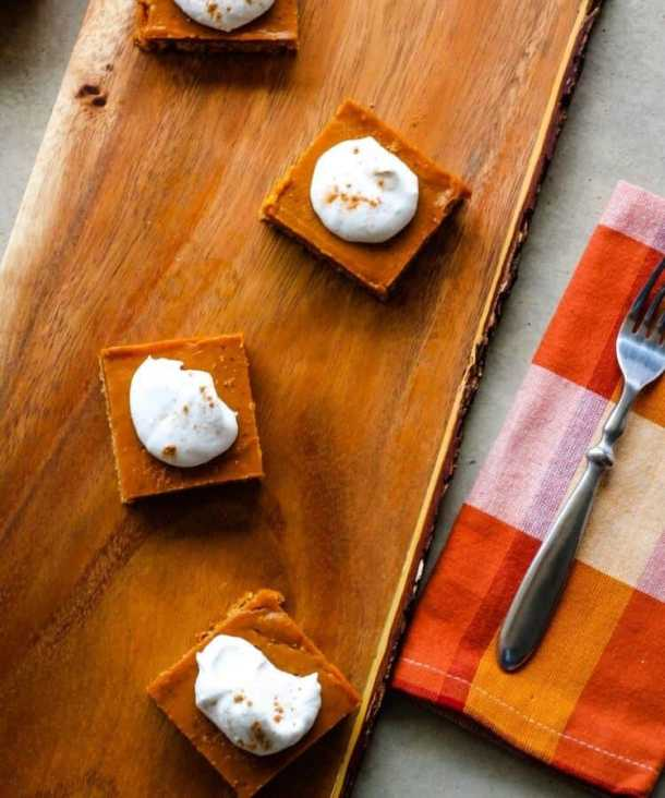 vegan gluten-free pumpkin pie bars on wood plank