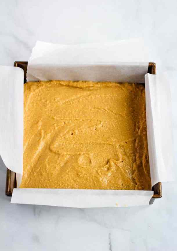 cornbread batter in pan lined with parchment paper