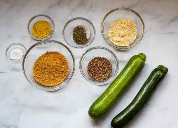 zucchini, breadcrumbs, and spices in bowls