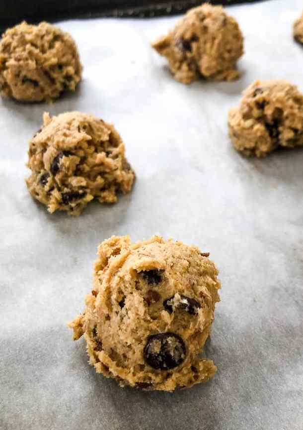 chocolate chip cookie dough balls on baking sheet