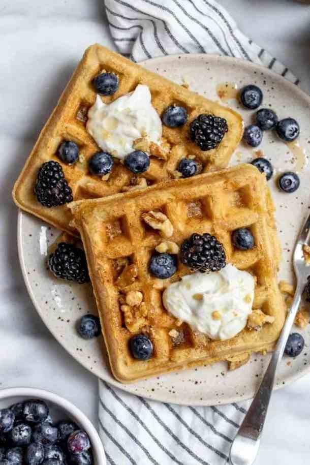 almond flour waffles topped with fresh berries and nuts