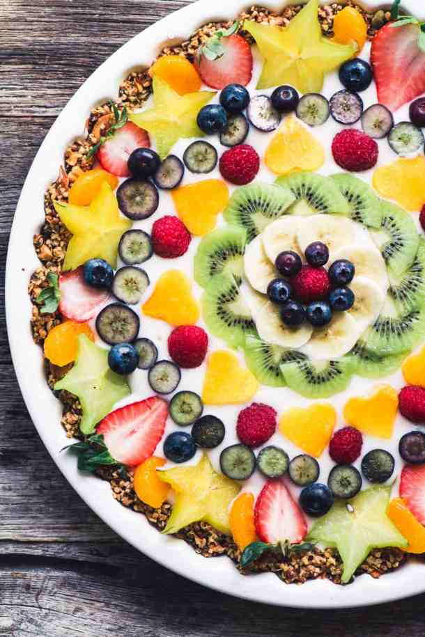 fruit tart topped with strawberries and other fruit