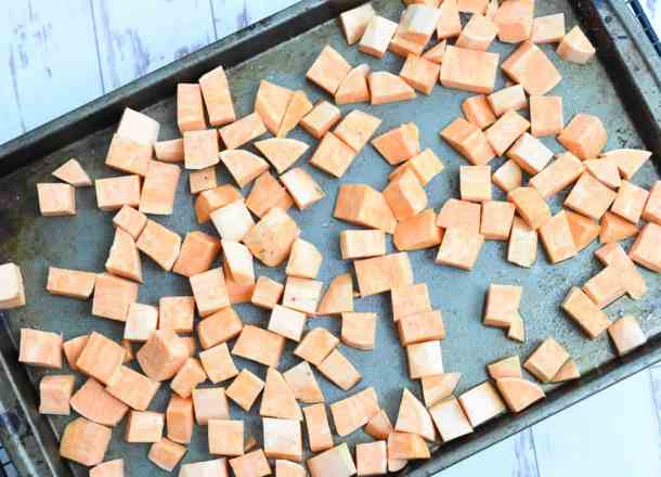 chopped sweet potatoes on sheet pan