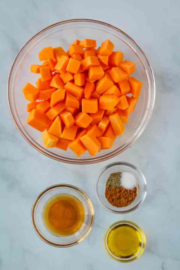 cubed butternut squash, olive oil, maple syrup, spices