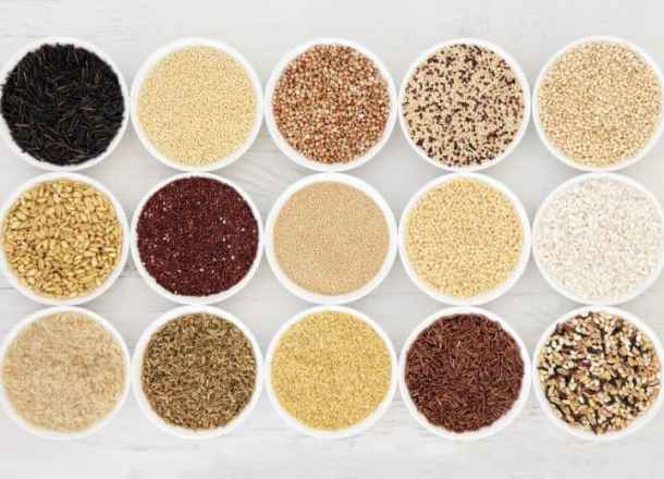 dried grains and legumes in white bowls
