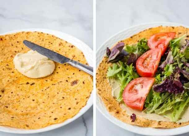 lavash covered in hummus, lettuce, and tomato