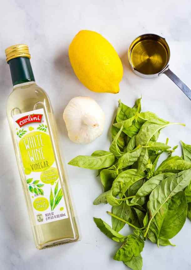white wine vinegar, basil, garlic, lemon, and olive oil