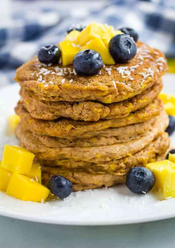 mango pancakes stacked on white plate