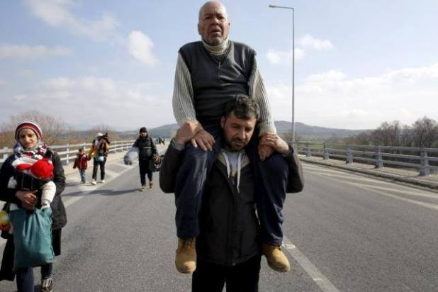 refugees man carrying man