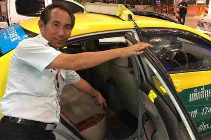 Thai cab driver Veeraphol Klamsiri points out location of missing money bag