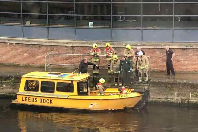 Fire crews arrived to pull the man from the water after the Leeds Water Taxi found the man in the water (Image: Twitter: @_OBlackburn)