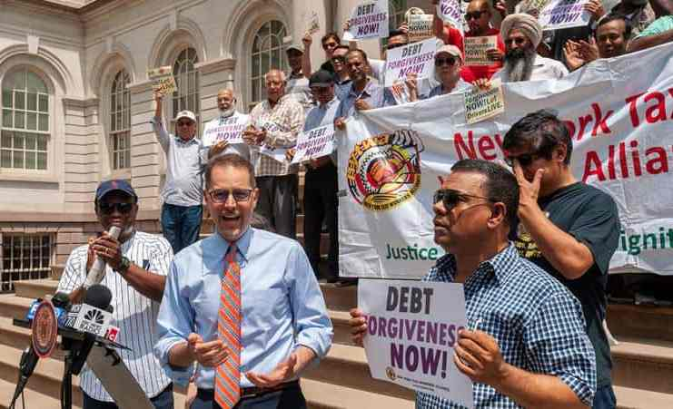 NYC Council Member Mark Levine speaks at a press conference with taxi drivers on the steps of NY City Hall calling for debt forgiveness for their medallions, July 11. | rblfmr/Shutterstock