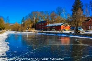 frozen canal reflecting blue skies