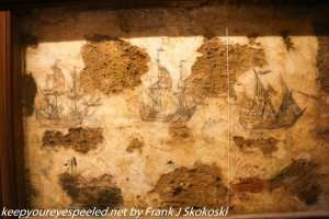drawings of ships on dungeon walls.