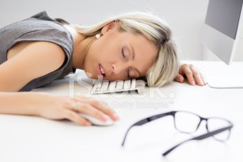 45927814-exhausted-woman-sleeping-in-front-of-computer