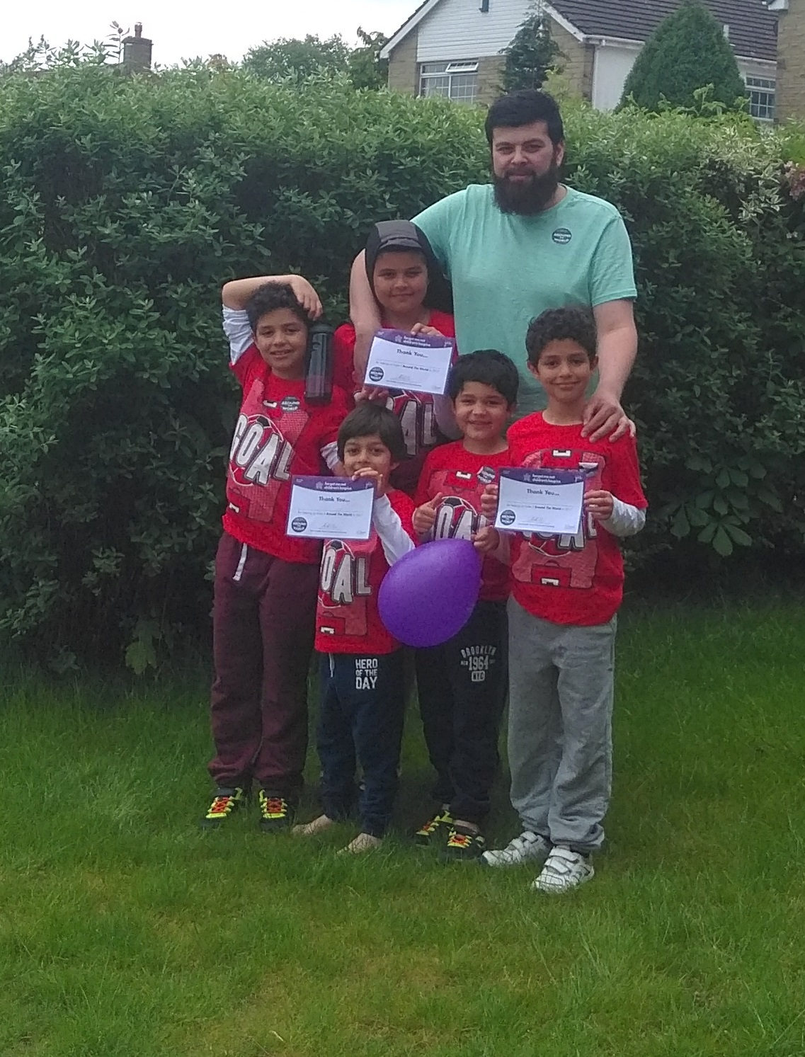 Vice president of Ahmadiyya Association Keighley Adam Walker with five of the seven Keighley children who took part in the charity walk