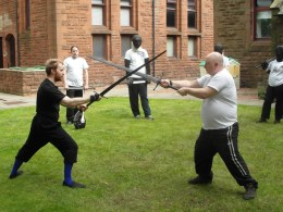 Keith demonstrating a technique with John McCann during a longsword lesson. Photo by Philippa Ramsay-Bagg, 2012.