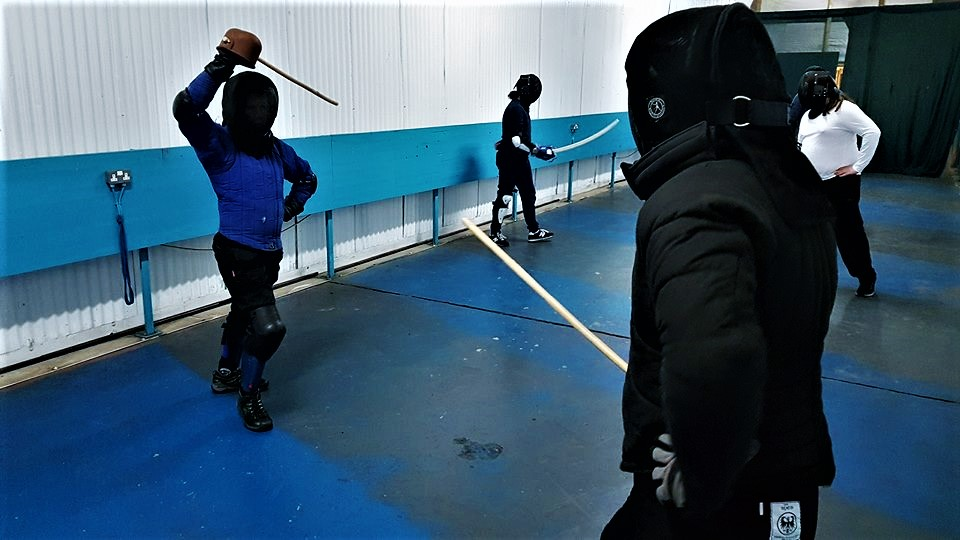 sparring with singlesticks