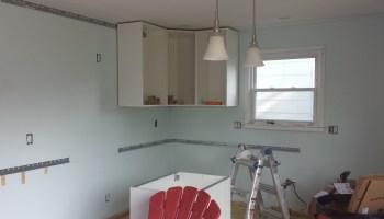 cabinet installation round 2 hanging ikea cabinets