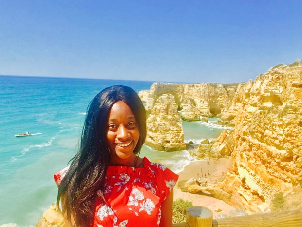 black lady travel blogger at Praia de Marinha Algavre Portugal