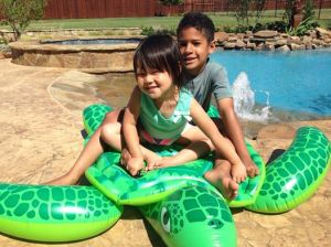 kids on turtle in texas