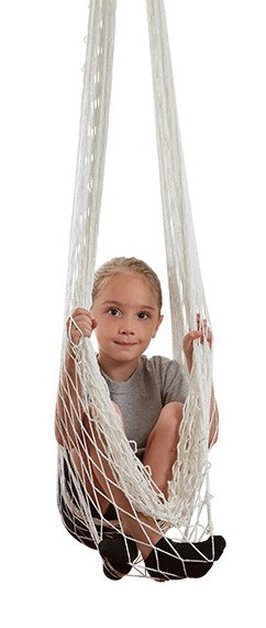 child in an open-weave hammock swing