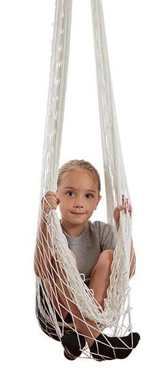 child in an open-weave hammock swing