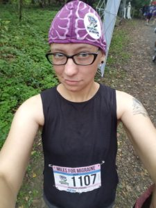 Me wearing a purple brain cap, with a race bib pinned to my shirt.