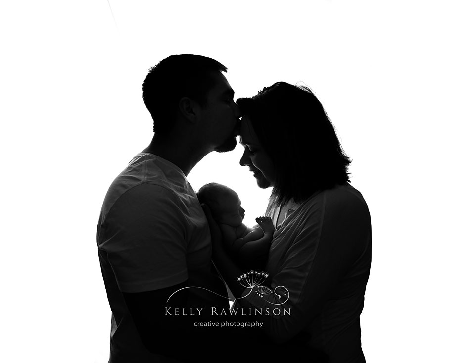 Bradford baby photographer, Kelly Rawlinson.  Black and white silhouette of new baby with parents.