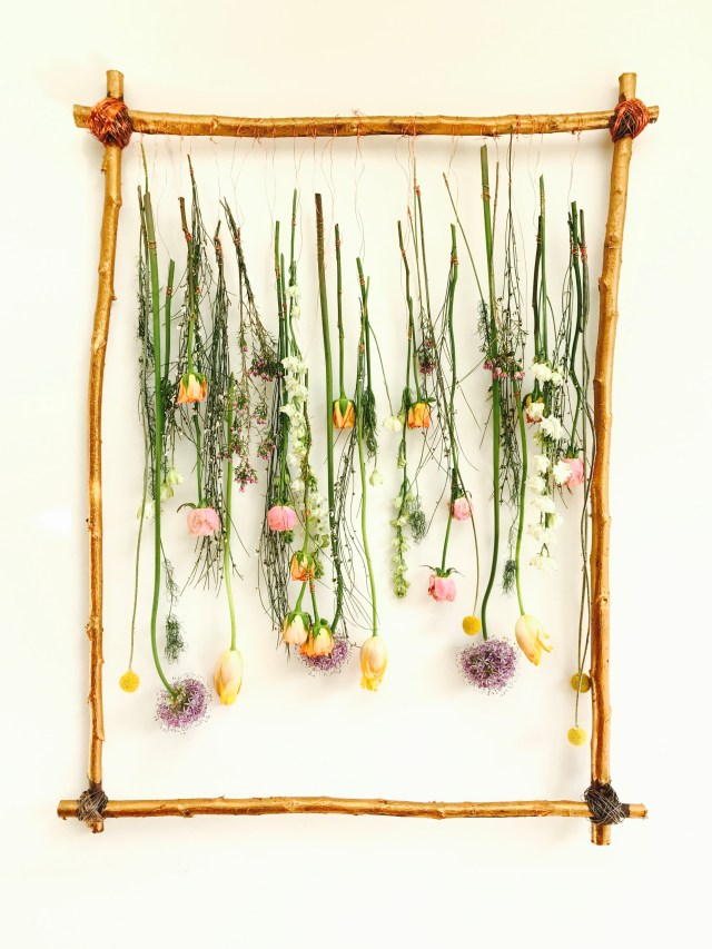 hanging flowers in a silver birch frame
