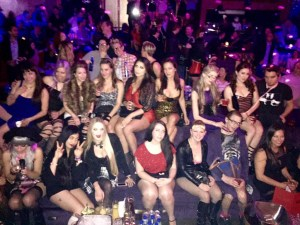 Group of Dommes and Kinkbomb.com party people partying in a club