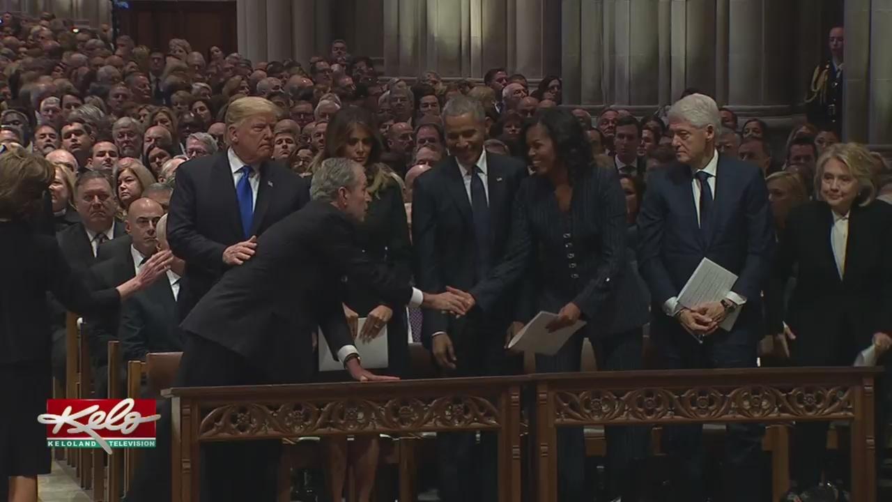 George W. Bush, Michelle Obama Share Moment Again