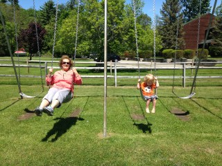 Grammy and Dillon swinging at the park in Hague, NY.
