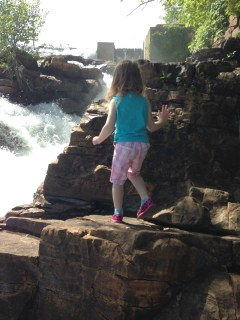 Rayleigh crawling up the rocks at the waterfall.