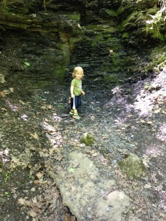 Dillon climbing the rock walls in Spa State Park.