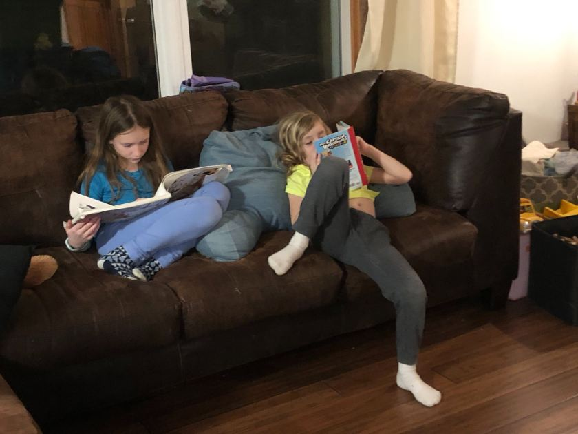 RK & Dman reading on the couch
