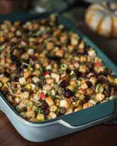 large casserole dish filled with baked apple pear stuffing with sausage